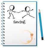A notebook with a sketch of two people fencing Royalty Free Stock Image