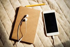 Notebook and smartphone with headset Royalty Free Stock Image