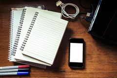 Notebook, smartphone, laptop,marker pen and gadget on antique wooden table Stock Photos