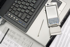 Notebook and smartphone. Office work. Notebook and smartphone. Close up Royalty Free Stock Image