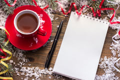 Notebook in the snow. Near the tree branches Royalty Free Stock Images