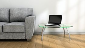 Notebook and sofa Stock Photography