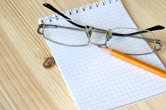 Notebook, spectacles and pencil Stock Photos