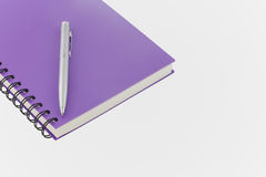 Notebook spiral bound and pen on white background Royalty Free Stock Photo