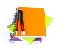 Notebook spiral bound and pencil on white background Stock Image