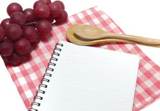 Notebook and spoon Royalty Free Stock Image