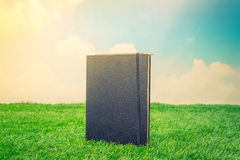.Notebook on spring green grass Royalty Free Stock Photography