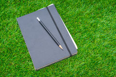 .Notebook on spring green grass Royalty Free Stock Photos