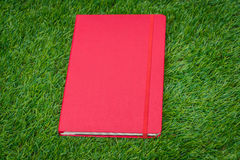 Notebook on spring green grass. Stock Photography