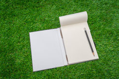 Notebook on spring green grass. Stock Images