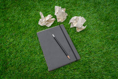 Notebook on spring green grass. Stock Photos