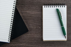 Notebook stack on the wood background with pen Stock Images