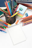 Notebook with stationary objects Royalty Free Stock Images
