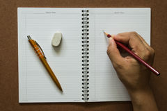 Notebook , with stationery equipment. On the table Stock Photo