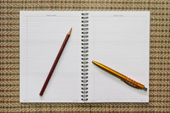 Notebook , with stationery equipment. On the table Royalty Free Stock Photo