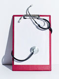 Notebook and stethoscope Royalty Free Stock Images