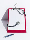 Notebook and stethoscope Stock Photo