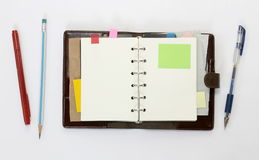 Notebook with sticky note Royalty Free Stock Images