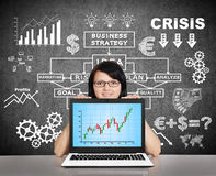 Notebook with stock chart  on screen Stock Photo