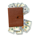 Notebook stuffed with  dollar bills Stock Images