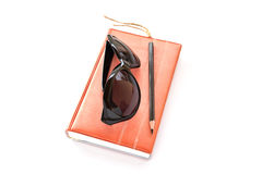 Notebook,sunglasses and pencil on white background Royalty Free Stock Photos