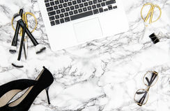 Notebook supplies accessories office desk Fashion flat lay. Notebook, supplies, feminine accessories on marble office desk background. Fashion flat lay for Royalty Free Stock Photos