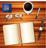 Notebook on table with other accessories Stock Images