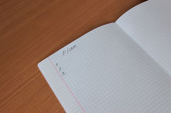 The notebook on the table. Notebook with a plan is on the surface of the table Stock Image