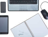 Notebook with tablet isolated on white background Royalty Free Stock Image