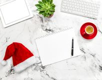 Notebook tablet pc Christmas decoration working desk Flat lay. Notebook, tablet pc, Christmas decoration on working desk. Flat lay. Business holidays Royalty Free Stock Images