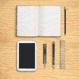Notebook and tablet on wood table Royalty Free Stock Photography