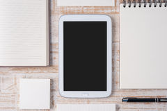 Notebook and tablet on wood table for background Royalty Free Stock Images