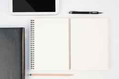 Notebook and tablet on wood table for background Royalty Free Stock Image