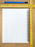 Notebook and tape measure Royalty Free Stock Image