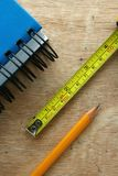 Notebook, tape measure and a pencil Royalty Free Stock Photography