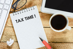 Notebook with tax time Stock Images