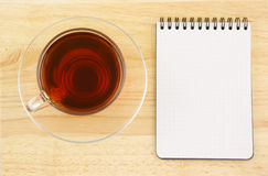 Notebook and tea cup Stock Image