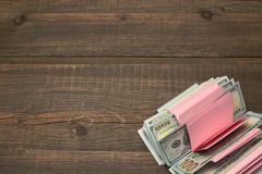 Notebook With Tear-off Sticker Pages And Dollar Cash On Wood Royalty Free Stock Photo