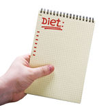 Notebook with the text of diet in hand Stock Image