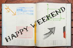 Notebook with text inside Happy Weekend on table with coffee, so Stock Photos
