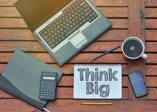 Notebook with text inside Think Big on table with coffee, mobile Stock Photography