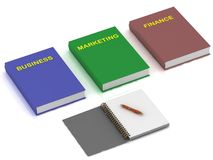Notebook and three books on the economy Royalty Free Stock Photos