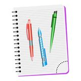 Notebook  and three pens on a white background Stock Image