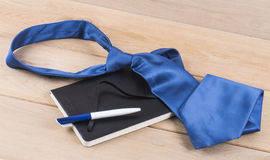Notebook and tie Royalty Free Stock Photography