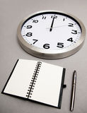 Notebook and time Stock Image