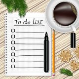 Notebook with to do list, fir tree branches, cookie, a pencil. A marker, and coffee cup on a table with wooden texture Stock Photography