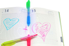 Notebook and two marker on a white Stock Images