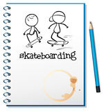 A notebook with two people skateboarding in the cover Royalty Free Stock Photo