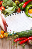 Notebook and  vegetables. Royalty Free Stock Image
