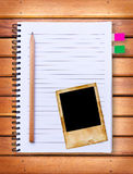 Notebook and vintage photo frame Stock Photos